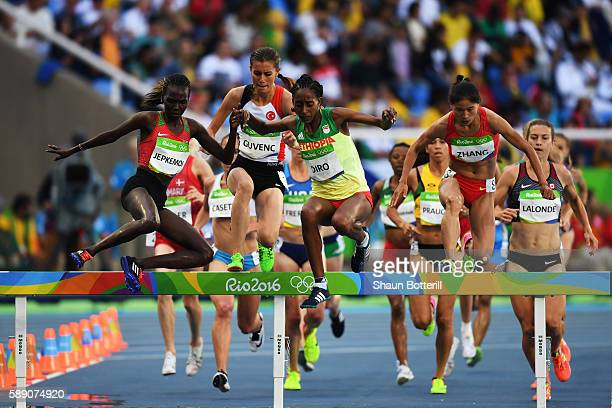 Xinyan Zhang of China Etenesh Diro of Ethiopia and Hyvin Kiyeng Jepkemoi of Kenya compete in the Women's 3000m Steeplechase Round 1 on Day 8 of the...