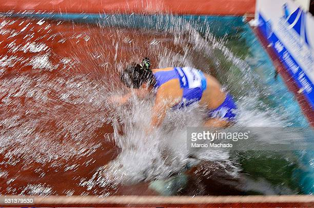 Xinyan Zhang of China runs in the Women��s 3000 Metres Steeple during the 2016 IAAF Diamond League meeting at Shanghai Stadiumon May 14 2016 in...