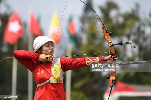 Xinyan Zhang of China shoots during Recurve Mixed Team Archery Final Rounds on day nine of the Asian Games on August 27 2018 in Jakarta Indonesia