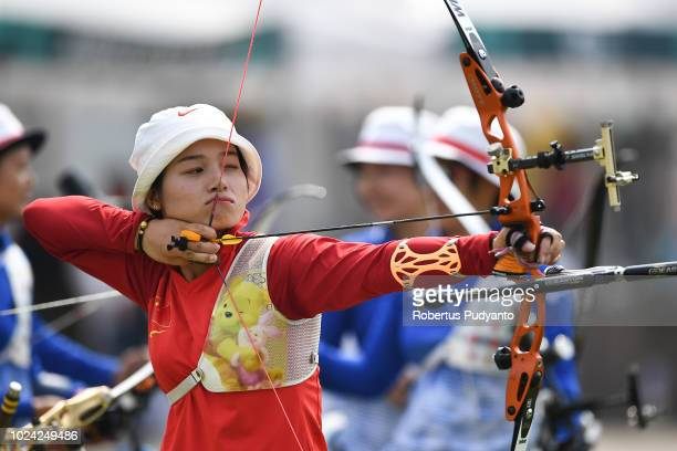 Xinyan Zhang of China shoots during Recurve Women's Team Archery Final Rounds on day nine of the Asian Games on August 27 2018 in Jakarta Indonesia