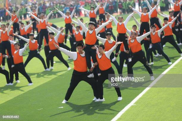 Xinyi Road Primary School students build human pyramid introduced from the National School Physical Education Leagues at Haigang District on April 16...