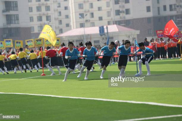 Xinyi Road Primary School students show sports meeting program introduced from the National School Physical Education Leagues at Haigang District on...