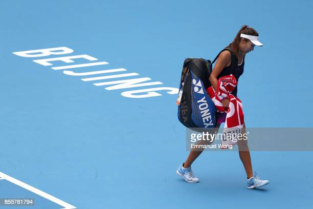 Xinyu Gao of China leaves the court after her match against Magda Linette of Poland on day one of the 2017 China Open at the China National Tennis...