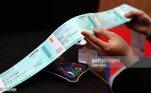 Xinyue Yang looks at Berlinale tickets she has just purchased prior to the opening of the Berlin International Film Festival or Berlinale on February...