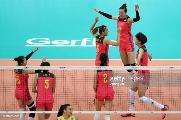 Xinyue Yuan #6 Xiangyu Gong #9 Changning Zhang #16 Xia Ding and team mates of China celebrate a point during the match between China and Brazil...