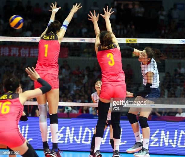 Xinyue Yuan and Fangxu Yang of China defend against Yeon Koung Kim of South Korea during the FIVB Volleyball Nations League 2018 at Beilun Gymnasium...