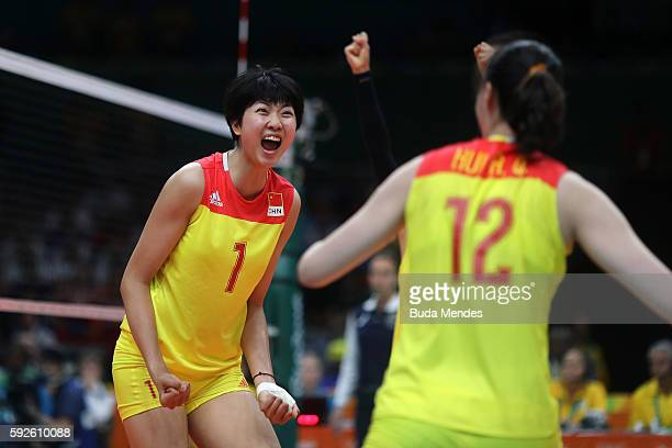 Xinyue Yuan and Ruoqi Hui of China celebrate during the Women's Gold Medal Match between Serbia and China on Day 15 of the Rio 2016 Olympic Games at...