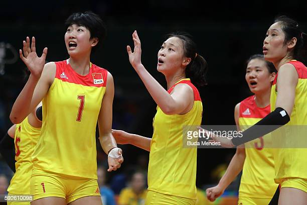 Xinyue Yuan and Ruoqi Hui of China dispute a call during the Women's Gold Medal Match between Serbia and China on Day 15 of the Rio 2016 Olympic...