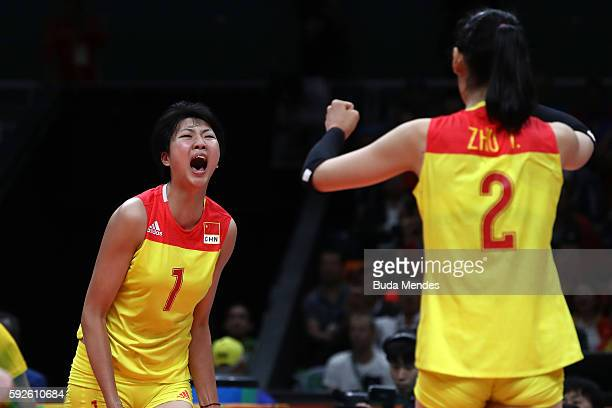 Xinyue Yuan and Ting Zhu of China celebrate during the Women's Gold Medal Match between Serbia and China on Day 15 of the Rio 2016 Olympic Games at...