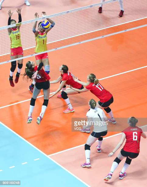 Xinyue Yuan and Xia Ding of China defend against Britt Herbots of Belgium during the FIVB Volleyball Nations League 2018 at Beilun Gymnasium on May...