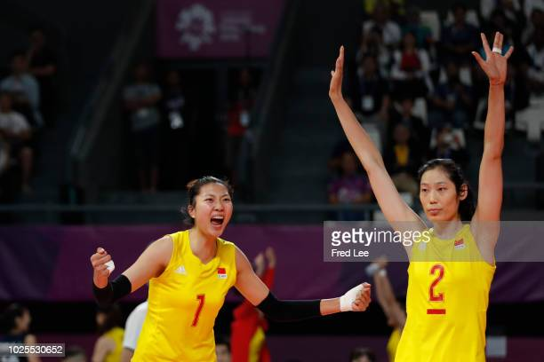 Xinyue Yuan and Zhu Ting of China celebrate during the Asian Games 2018 Volleyball Women's Semifinals between China and Japan on day thirteen of the...