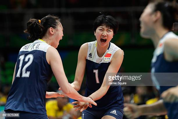 Xinyue Yuan of China celebrates a point over the Netherlands during the Women's Volleyball Semifinal match at the Maracanazinho on Day 13 of the 2016...