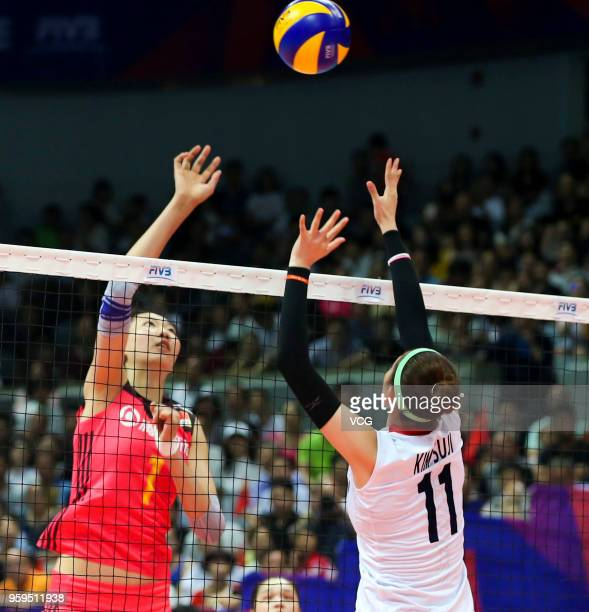 Xinyue Yuan of China competes against Su Ji Kim of South Korea during the FIVB Volleyball Nations League 2018 at Beilun Gymnasium on May 17 2018 in...