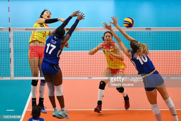 Xinyue Yuan of China spikes during the FIVB Women's World Championship semi final between China and Italy at Yokohama Arena on October 19 2018 in...