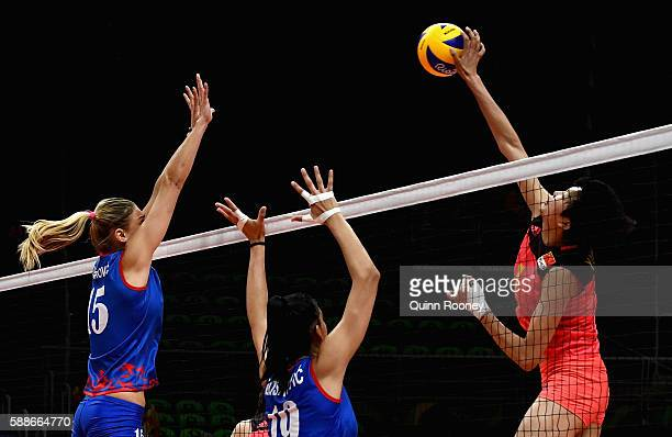 Xinyue Yuan of China spikes the ball during the Women's preliminary volleyball match between Serbia and China on Day 7 of the Rio 2016 Olympic Games...