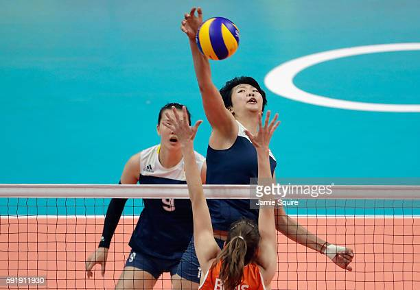 Xinyue Yuan of China strikes the ball against the Netherlands during the Women's Volleyball Semifinal match at the Maracanazinho on Day 13 of the...