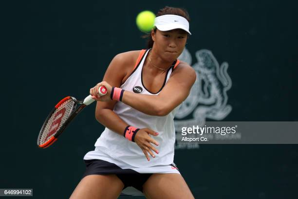Xinyun Han of China in action against Anna Kalinskaya of Russia during Round of 16 of the 2017 WTA Malaysian Open at the TPC on March 2 2017 in Kuala...