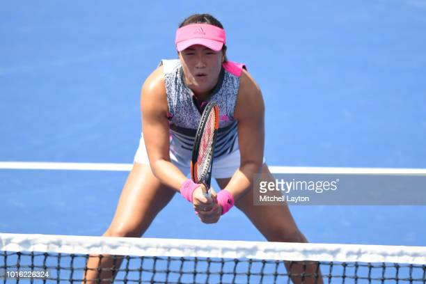 Xinyun Han of China prepares for a shot during the Women's Doubles semifinal against Belinda Bencic of Switzerland and Anhelina Kalinina of Ukraine...
