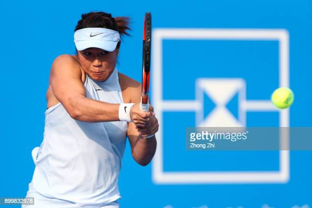 Xinyun Han of China returns a shot during the qualification match against Lesley Kerkhove of the Netherlands during 2018 WTA Shenzhen Open at...