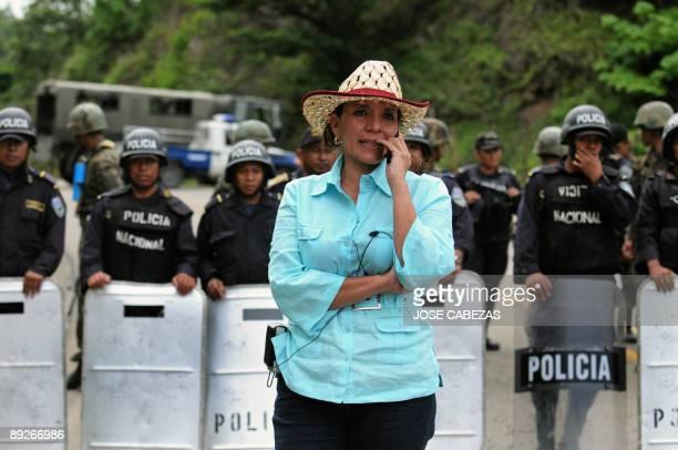 Xiomara Castro de Zelaya wife of ousted president of Honduras Manuel Zelaya speaks in her mobile phone in a military road blockade near the town of...