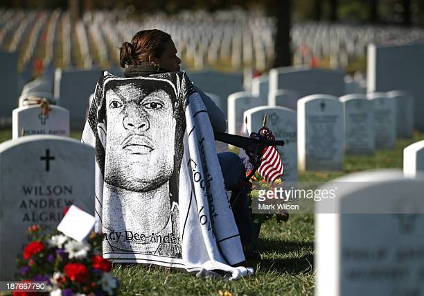 Xiomara Mena Anderson sits at the gravesite of her son US Army Cpl Andy Anderson who was killed in Afghanistan at Section 60 in Arlington Cemetery...