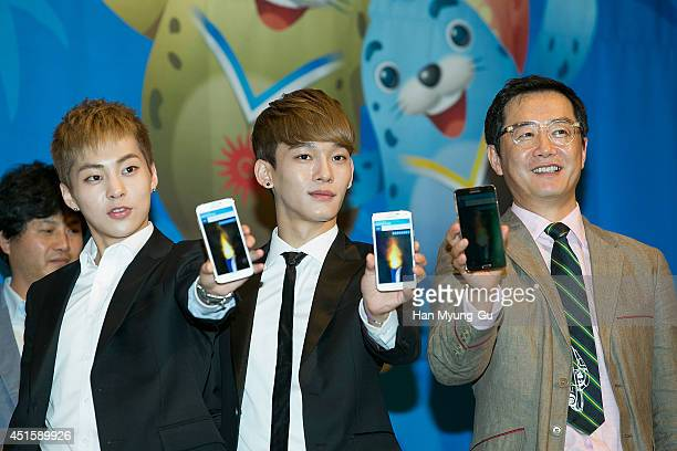 Xiumin Chen of boy band EXOM and director Jang Jin attend the press conference for the 17th Asian Games Incheon 2014 on July 1 2014 in Seoul South...