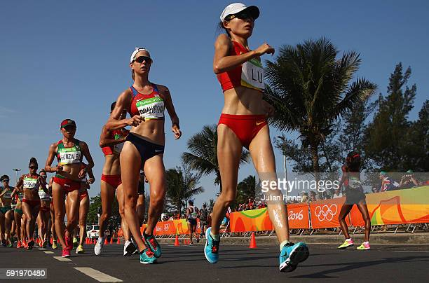 Xiuzhi Lu of China leads the group as they compete in the Women's 20km Walk final on Day 14 of the Rio 2016 Olympic Games at Pontal on August 19 2016...