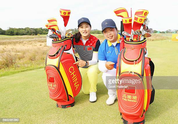 Xiyu Lin and Shanshan Feng of China pose together during a practice round prior to the start of the women's golf during Day 11 of the Rio 2016...