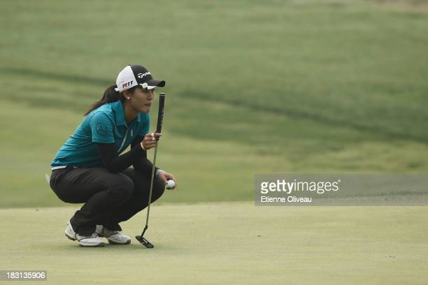 Xiyu Lin of China lines up a putt during the third round of the Reignwood LPGA Classic at Pine Valley Golf Club on October 5 2013 in Beijing China