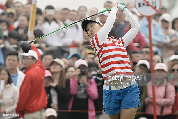 Xiyun Lin of China tees of her first tee during the final round of the Reignwood LPGA Classic at Pine Valley Golf Club on October 6 2013 in Beijing...