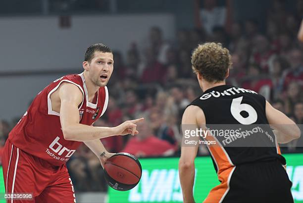 xJanis Strelnieks dribbels the ball against Per Günther during the BEKO BBL Final game 1 between Brose Baskets Bamberg and ratipopharm Ulm at Brose...