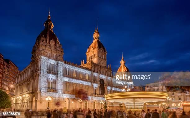 xmas lights and carnival in la coruña. city hall - provincia de a coruña fotografías e imágenes de stock