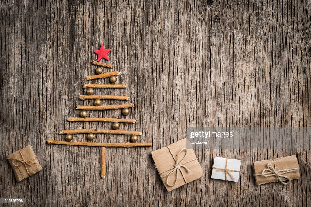 Xmas tree and gift box on rustic wooden background : Stock Photo