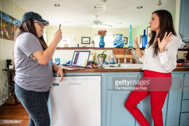 Xochitl Ramirez holds up her phone as Cristina Tzintzún Ramirez livestreams on Instagram at her home in Austin Texas on Sunday Jan 13 2020 Ramirez...