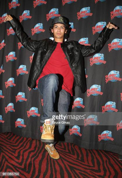 Xolo Mariduena poses as he promotes his tv series Cobra Kai at Planet Hollywood Times Square on April 25 2018 in New York City