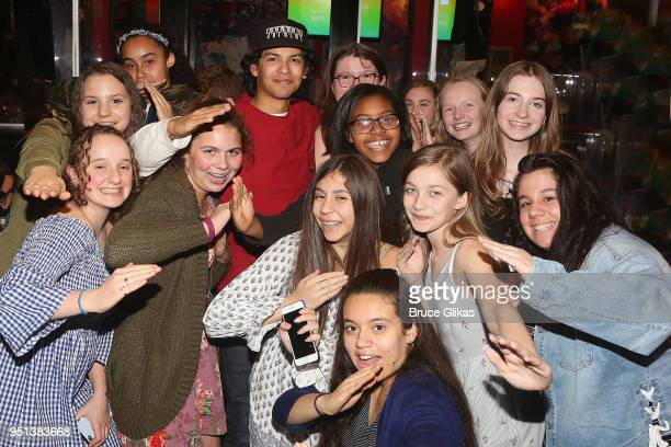 Xolo Mariduena poses with fans as he promotes his tv series Cobra Kai at Planet Hollywood Times Square on April 25 2018 in New York City