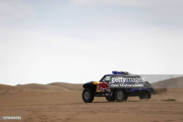 Raid Mini Jcw Team no 300 MINI JOHN COOPER WORKS BUGGY car driven by Carlos Sainz of Spain and Lucas Cruz of Spain ompete in the desert during Stage...