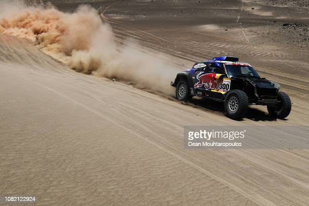 Raid Mini Jcw Team no 300 MINI JOHN COOPER WORKS BUGGY car driven by Carlos Sainz of Spain and Lucas Cruz of Spain compete in the desert on the sand...