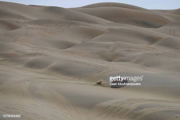 Raid Team no 321 MINI ALL 4 RACING car driven by Boris Garafulic of Chile and Filipe Palmeiro of Portugal compete in the desert during Stage Two of...