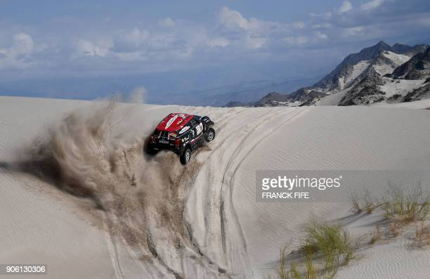 Raid Team's Argentinian driver Orlando Terranova and codriver Bernardo Graue compete with their Mini during the Stage 11 of the 2018 Dakar Rally...