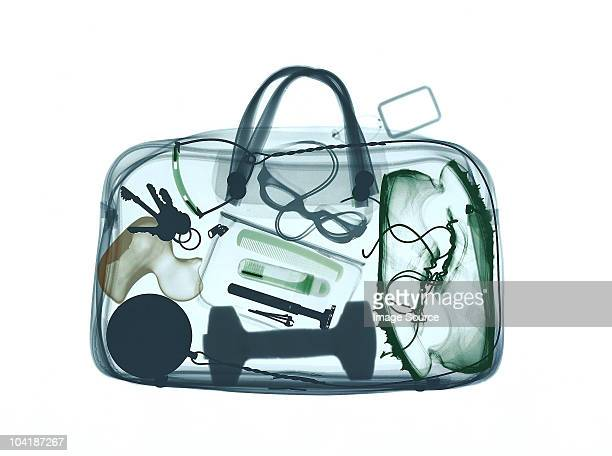 xray image of bag containing sports equipment - toiletries stock pictures, royalty-free photos & images