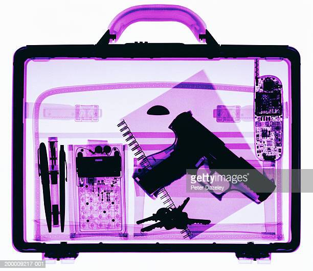 x-ray image of briefcase containing hand gun - trigger stock photos and pictures