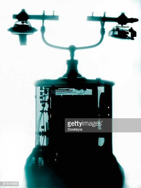 x-ray of an old fashioned telephone (toned) - candlestick phone stock pictures, royalty-free photos & images