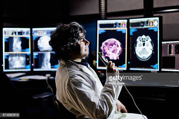 x-ray technician in laboratory - diagnostic medical tool stock pictures, royalty-free photos & images