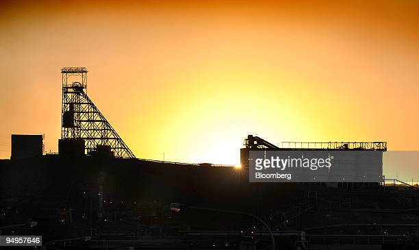 Xstrata Plc's Mt Isa mining machinery formerly used to transport miners to the underground copper mine is silhouetted in Mount Isa Queensland...