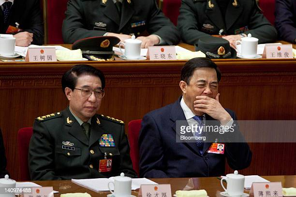 Xu Caihou vice chairman of China's Central Military Commission left and Bo Xilai Chinese Communist Party secretary of Chongqing attend a plenary...