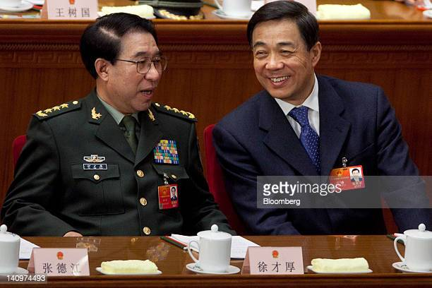 Xu Caihou vice chairman of China's Central Military Commission left speaks with Bo Xilai Chinese Communist Party secretary of Chongqing at a plenary...