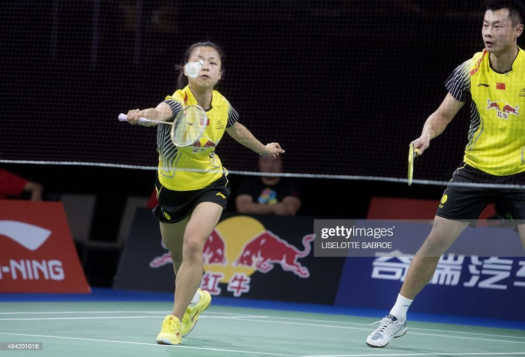 Xu Chen and Ma Jin from China play against Mads Pieler Kolding and Kamilla Rytter Juhl (not in picture) from Denmark during their match at the 2014 BWF Badminton World championships held at the Ballerup Super Arena in Copenhagen on August 26, 2014.