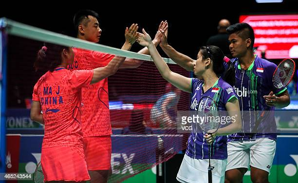 Xu Chen and Ma Jin of China clap hands with Praveen Jordan and Debby Susanto of Indonesia during Mixed Doubles match on day two of YONEX All England...