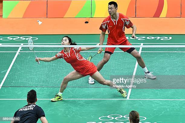 Xu Chen and Ma Jin of China compete against Fischer Nielsen Joachim and Pedersen Christinna of Denmark during the Mixed Doubles Badminton match on...